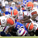 Buffalo Bills running back Fred Jackson (22) lies over the ball after he fumbled it as Cleveland Browns long snapper Christian Yount (57), cornerback Johnson Bademosi (24), inside linebacker Tank Carder (59) and linebacker Zac Diles (54) hover over him du
