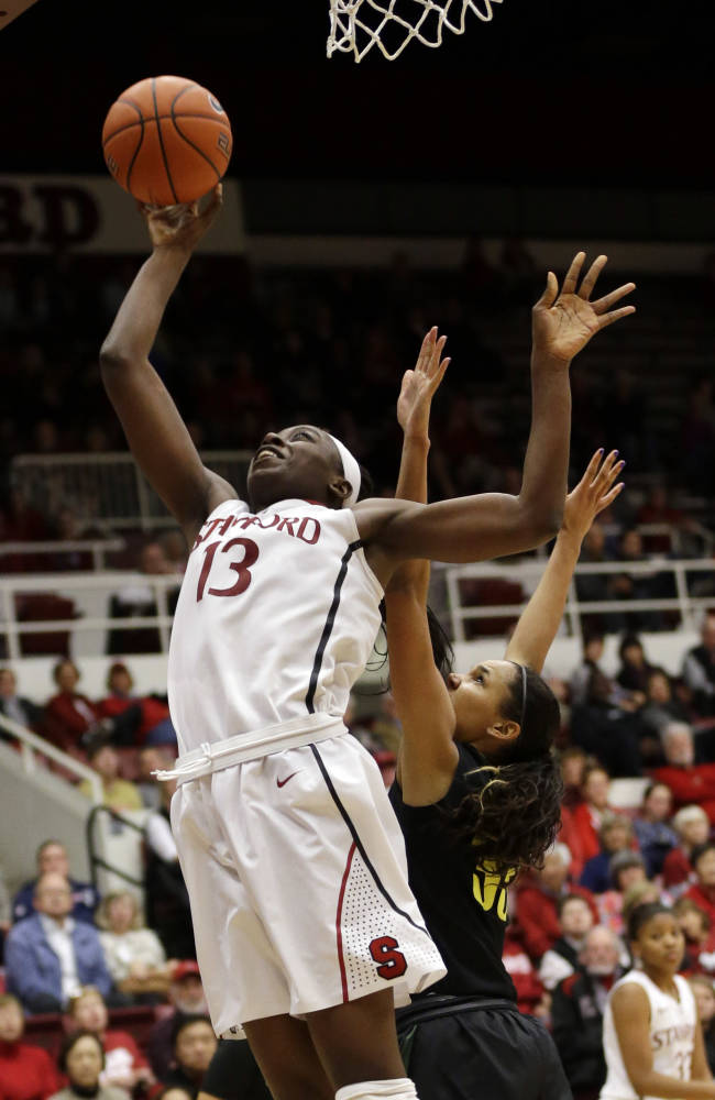 Stanford 's Chiney Ogwumike (13) scores on a layup next to Oregon's Lexi Petersen (33) during the second half of an NCAA college basketball game on Friday, Jan. 3, 2014, in Stanford, Calif