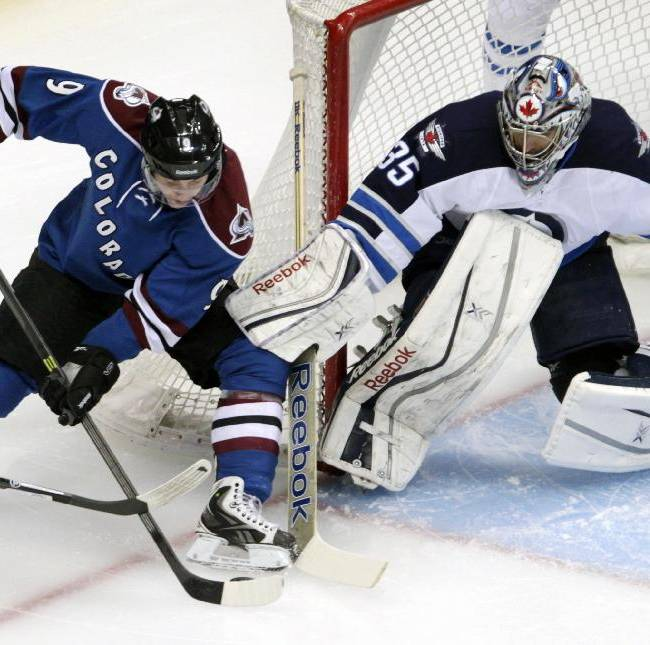 Colorado Avalanche center Matt Duchene (9) drives to the goal against Winnipeg Jets goalie Al Montoya (35) during the first period of an NHL hockey game in Denver on Sunday, Dec. 29, 2013