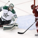 Arizona Coyotes' Mikkel Boedker (89), of Denmark, scores a goal against Dallas Stars' Kari Lehtonen, of Finland, during the third period of an NHL hockey game Tuesday, Nov. 11, 2014, in Glendale, Ariz. The Stars defeated the Coyotes 4-3 The Associated Pre