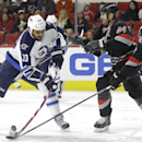 Carolina Hurricanes' Jay Harrison (44) and Jay McClement (18) defend Winnipeg Jets' Dustin Byfuglien (33) during the first period of an NHL hockey game in Raleigh, N.C., Thursday, Nov. 13, 2014 The Associated Press