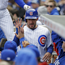 Chicago Cubs' Ryan Kalish celebrates with teammates after he scored on a sacrifice fly by Nate Schierholtz during the first inning of a baseball game against the Philadelphia Phillies in Chicago, Sunday, April 6, 2014 The Associated Press