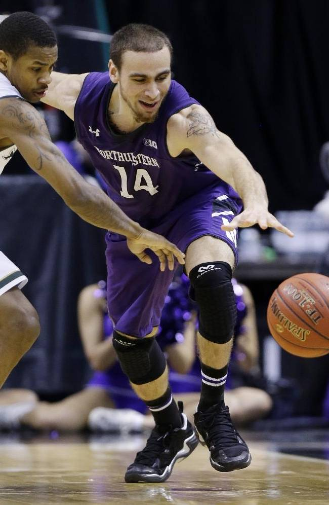 Michigan State guard Keith Appling (11) and Northwestern guard Tre Demps (14) chase a loose ball in the second half of an NCAA college basketball game in the quarterfinals of the Big Ten Conference tournament Friday, March 14, 2014, in Indianapolis