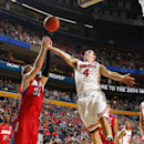 Ohio State's Aaron Craft (4) fights for control of the ball with Dayton's Matt Kavanaugh (35) during the first half of a second-round game in the NCAA college basketball tournament in Buffalo, N.Y., Thursday, March 20, 2014 The Associated Press