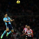 West Ham United's Stewart Downing, left, vies for the ball with Sunderland's Lee Cattermole, right, during their English Premier League soccer match at the Stadium of Light, Sunderland, England, Saturday, Dec. 13, 2014