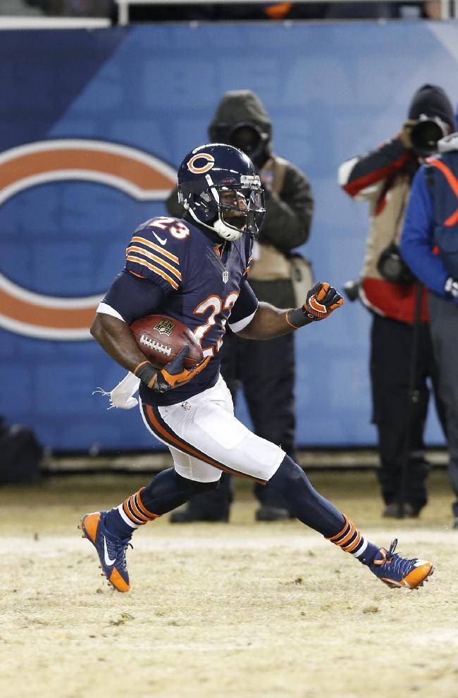 Chicago Bears wide receiver Devin Hester (23) runs on a kick off return during the first half of an NFL football game against the Green Bay Packers, Sunday, Dec. 29, 2013, in Chicago