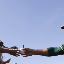 Oakland Athletics center fielder Coco Crisp, right, reaches for a ball as he signs autographs before the Athletics played the Milwaukee Brewers in a spring training baseball game Thursday, Feb. 27, 2014, in Scottsdale, Ariz The Associated Press