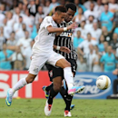 Santos' Neymar, left, fights for the ball with Corinthians' Gil, during the final match of the Sao Paulo State soccer league in Santos, Brazil, Sunday, May 19, 2013. (AP Photo/Andre Penner)