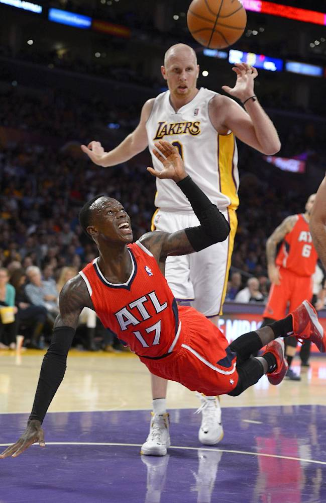 Atlanta Hawks guard Dennis Schroder, of Germany,, below, puts up a shot as Los Angeles Lakers center Chris Kaman defends during the second half of their NBA basketball game, Sunday, Nov. 3, 2013, in Los Angeles. The Lakers won 105-103