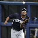 New York Yankees' Zoilo Almonte catches a fly ball hit by Tampa Bay Rays' Ryan Hanigan during the first inning of an exhibition baseball game, Wednesday, March 5, 2014, in Port Charlotte, Fla The Associated Press