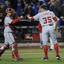 Washington Nationals catcher Jose Lobaton, left, congratulates relief pitcher Craig Stammen (35) after they defeated the New York Mets 5-1 in a baseball game at Citi Field on Wednesday, April 2, 2014, in New York The Associated Press