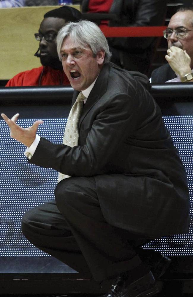 New Mexico coach Craig Neal delivers instructions to his team during the first half of an NCAA college basketball game against Grand Canyon in Albuquerque, N.M., Monday, Dec. 23, 2013. New Mexico won 80-68