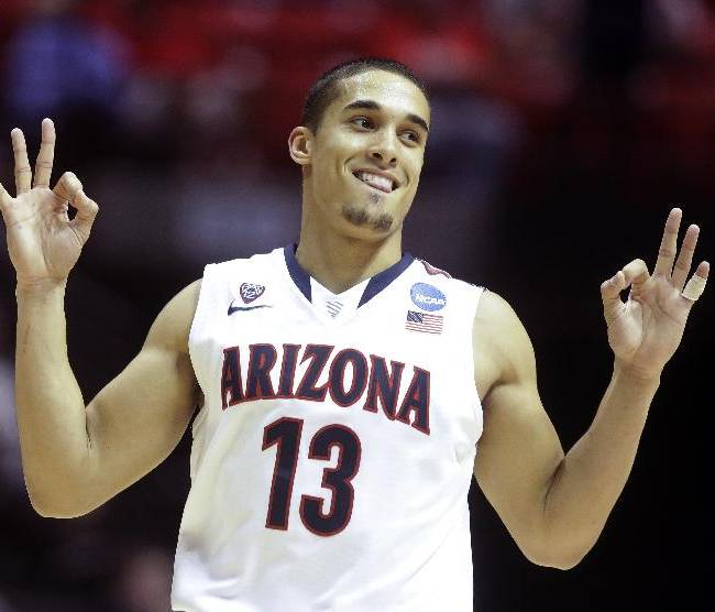 Arizona guard Nick Johnson gestures after making a three-point basket against Gonzaga during the second half of a third-round game in the NCAA college basketball tournament Sunday, March 23, 2014, in San Diego