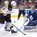 Toronto Maple Leafs goalie Jonathan Bernier (45) makes a save on Boston Bruins forward Patrice Bergeron (37) during the first period of an NHL hockey game Wednesday, Nov. 12, 2014, in Toronto The Associated Press