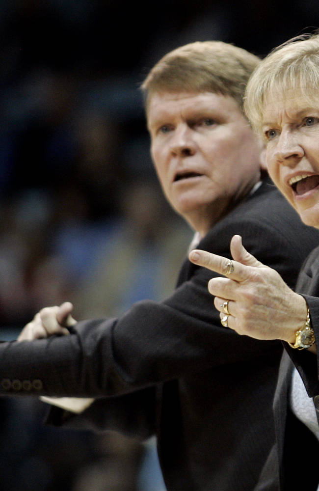 In this Jan. 17, 2010 file photo, North Carolina head coach Sylvia Hatchell, right, and associate head coach Andrew Calder instructs their team during the second half of an NCAA college basketball game against Maryland in Chapel Hill, N.C. Hatchell, in a release from the school on Monday, Oct. 14, 2013, said she would temporarily step away from her coaching duties to focus on treatment for leukemia. Now it's up to longtime assistant Calder to keep things running smoothly until Hatchell can return