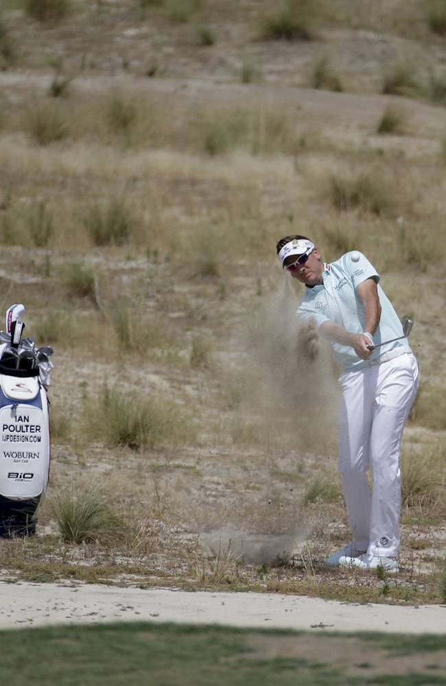 Ian Poulter, of England hits from the waste area on the fifth hole during a practice round for the U.S. Open golf tournament in Pinehurst, N.C., Tuesday, June 10, 2014. The tournament starts Thursday