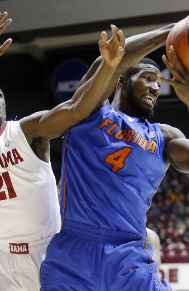Florida center Patric Young (4) gets the rebound from Alabama's Rodney Cooper (21) during an NCAA college basketball game at Coleman Coliseum in Tuscaloosa, Ala., Thursday, Jan. 23, 2014