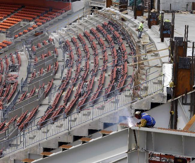 A worker welds an I-beam at the east end-zone at FirstEnergy Stadium, Monday, June 16, 2014, in Cleveland. During Phase One of the renovation, two new escalators in the east and west end-zones will be installed