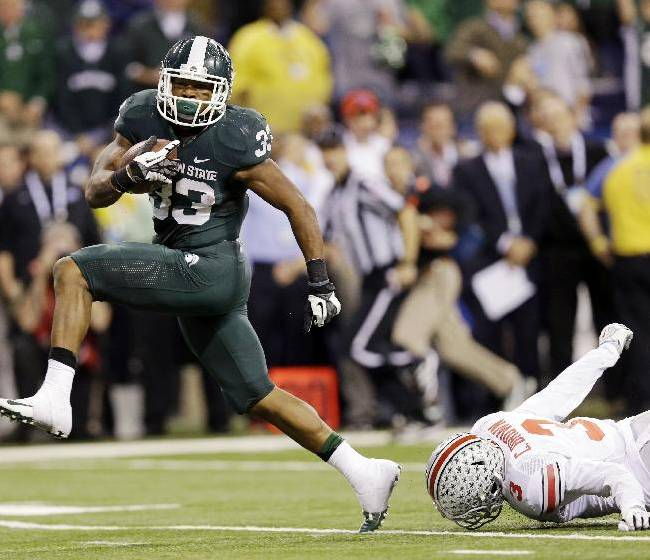 Michigan State's Jeremy Langford (33) runs out of the tackle of Ohio State's Corey Brown (3) for a 26-yard touchdown run during the fourth quarter of an Big Ten Conference championship NCAA college football game Saturday, Dec. 7, 2013, in Indianapolis. Michigan State won 34-24