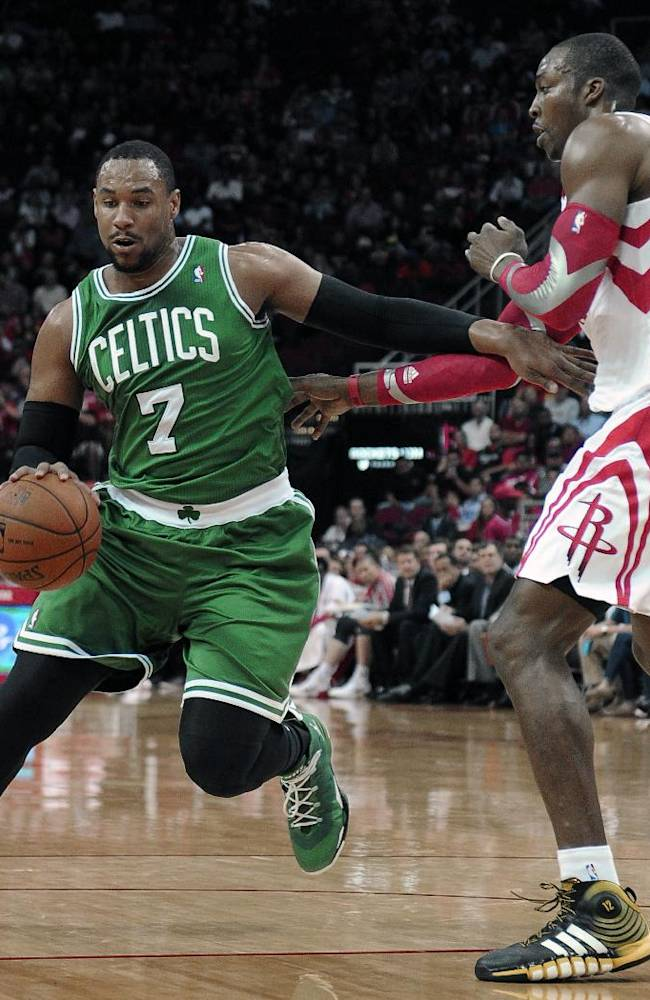 Boston Celtics' Jared Sullinger (7) drives the ball around Houston Rockets' Dwight Howard in the first half of an NBA basketball game Tuesday, Nov. 19, 2013, in Houston