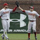 Arizona Diamondbacks center fielder Tony Campana, right, celebrates with left fielder Roger Kieschnick after the Diamondbacks defeated the Chicago Cubs 5-2 in a baseball game in Chicago, Thursday, April 24, 2014 The Associated Press