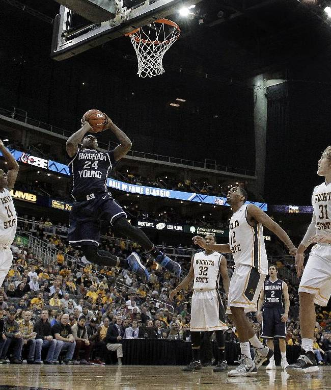 BYU's Frank Bartley IV puts up a shot during the second half of an NCAA college basketball game against Wichita State on Tuesday, Nov. 26, 2013, in Kansas City, Mo. Wichita State won 75-62
