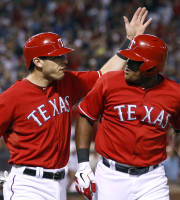 Texas Rangers' Adrian Beltre, right, is congratulated by Ian Kinsler after his two-run home run against the Houston Astros during the sixth inning of a baseball game, Tuesday, Aug. 20, 2013, in Arlington, Texas. (AP Photo/Jim Cowsert)
