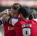 Arsenal's Olivier Giroud, left, celebrates with teammates Mikel Arteta and Bacary Sagna, after scoring against Everton, during their FA Cup quarterfinal soccer match, at Emirates Stadium, in London, Saturday, March 8, 2014