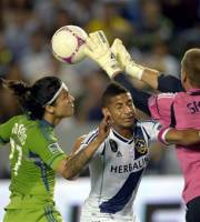 Seattle Sounders FC forward Fredy Montero, left, and Los Angeles Galaxy defender Sean Franklin, center, collide with Galaxy goalkeeper Josh Saunders as he makes a save during the first half of their MLS soccer match, Sunday, Oct. 28, 2012, in Carson, Calif. (AP Photo/Mark J. Terrill)