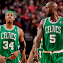 PORTLAND, OR - FEBRUARY 24: Paul Pierce #34 and Kevin Garnett #5 of the Boston Celtics wait to resume action against the Portland Trail Blazers on February 24, 2013 at the Rose Garden Arena in Portland, Oregon. (Photo by Cameron Browne/NBAE via Getty Images)