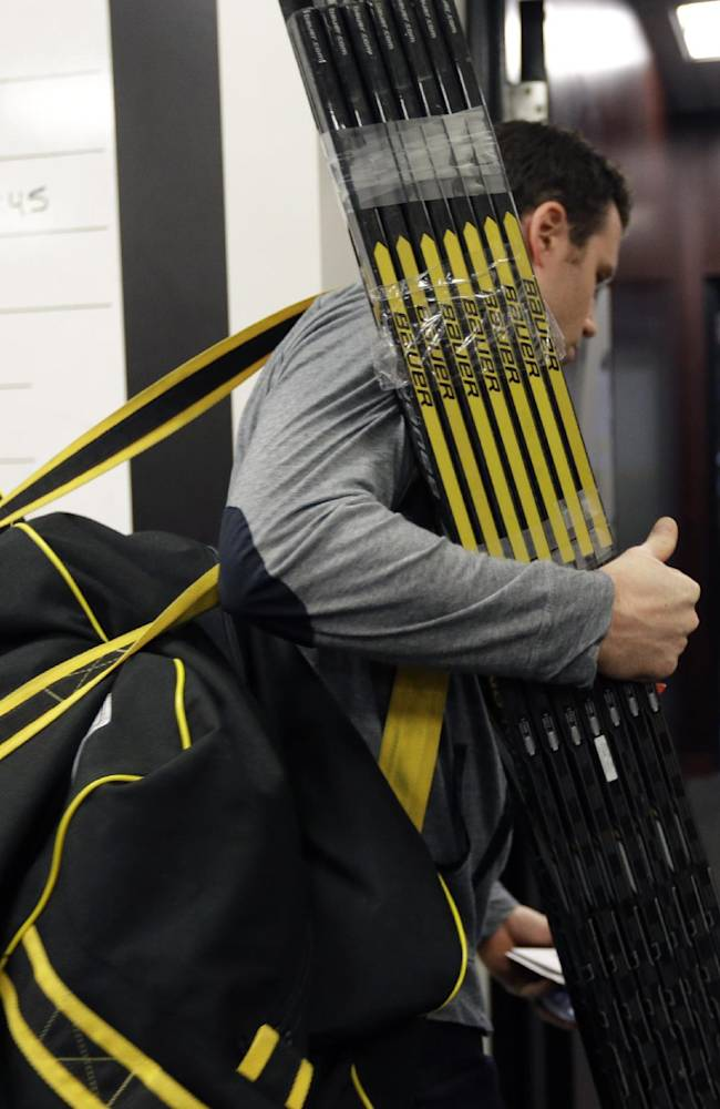Boston Bruins' Corey Potter departs carries his equipment out of team's locker room at TD Garden Friday, May 16, 2014, in Boston. The Montreal Canadiens eliminated the Bruins with a 3-1 win in Game 7 of their second-round Stanley Cup playoff NHL hockey series on Wednesday