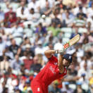 England's Alastair Cook plays a shot off the bowling of South Africa's Jean-Paul Duminy during their ICC Champions Trophy semifinal cricket match at the Oval cricket ground in London, Wednesday, June 19, 2013. (AP Photo/Sang Tan)