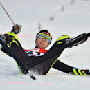 France's winner Jason Lamy Chappuis lies in the finish area after the Nordic Combined World Cup competition in Ramsau, Austria, on Sunday, Dec. 21, 2014. (AP Photo/Kerstin Joensson)