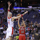 Chicago Bulls guard Kirk Hinrich (12) shoots against Washington Wizards center Marcin Gortat (4), of Poland, during the first half of an NBA basketball game, Saturday, April 5, 2014, in Washington The Associated Press