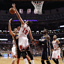 Chicago Bulls center Joakim Noah (13) blocks the shot of Indiana Pacers forward Luis Scola, left, as Roy Hibbert (55) and Taj Gibson (22) watch during the first half of an NBA basketball game Monday, March 24, 2014, in Chicago The Associated Press