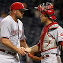 Cincinnati Reds relief pitcher Jonathan Broxton, left, celebrates with catcher Devin Mesoraco after getting the final out in the ninth inning of a baseball game against the Pittsburgh Pirates in Pittsburgh Wednesday, April 23, 2014. The Reds won 5-2 The A