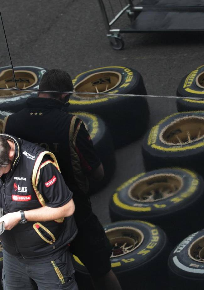 A technician fills in some documents at the paddock, ahead of Sunday's Belgian Formula One Grand Prix in Spa-Francorchamps, Belgium, Thursday, Aug. 21, 2014