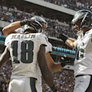 Philadelphia Eagles wide receiver Jeremy Maclin, left, celebrates his touchdown catch with wide receiver Riley Cooper and tight end Zach Ertz during the second half of an NFL football game, Sunday, Sept. 7, 2014, in Philadelphia. The Eagles won 34-17 The