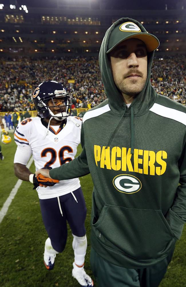 Green Bay Packers' Aaron Rodgers shakes hands with Chicago Bears' Tim Jennings (26) after an NFL football game Monday, Nov. 4, 2013, in Green Bay, Wis. Rodgers was injured in the first half of the game and did not return. The Bears won 27-20