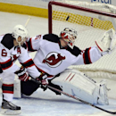 New Jersey Devils defenseman Andy Greene (6) and goaltender Cory Schneider, right, can't stop the shot from Buffalo Sabres' Tyler Ennis, who scored his second goal in the third period of an NHL hockey game in Buffalo, N.Y., Tuesday, April 1 2014. Buffalo