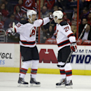 New Jersey Devils center Travis Zajac, left, celebrates with defenseman Damon Severson, after Severson's first goal in the first period of an NHL hockey game against the Washington Capitals, Thursday, Oct. 16, 2014, in Washington The Associated Press
