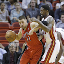 Toronto Raptors center Jonas Valanciunas (17) of Lithuania, drives up against Miami Heat forward Udonis Haslem (40) during the first half of an NBA basketball game, Monday, March 31, 2014 in Miami The Associated Press
