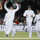 England's players (from left) Steven Finn, Graeme Swann, Alastair Cook and Matt Prior celebrate the wicket of  New Zealand's BJ Watling, right, in their first test match at Lord's cricket ground in London, Saturday, May 18, 2013. (AP Photo/Kirsty Wigglesworth)