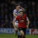 Queens Park Rangers' Joey Barton, background, competes for the ball with Manchester United's Daley Blind during the English Premier League soccer match between QPR and Manchester United at Loftus Road stadium in London, Saturday, Jan. 17, 2015