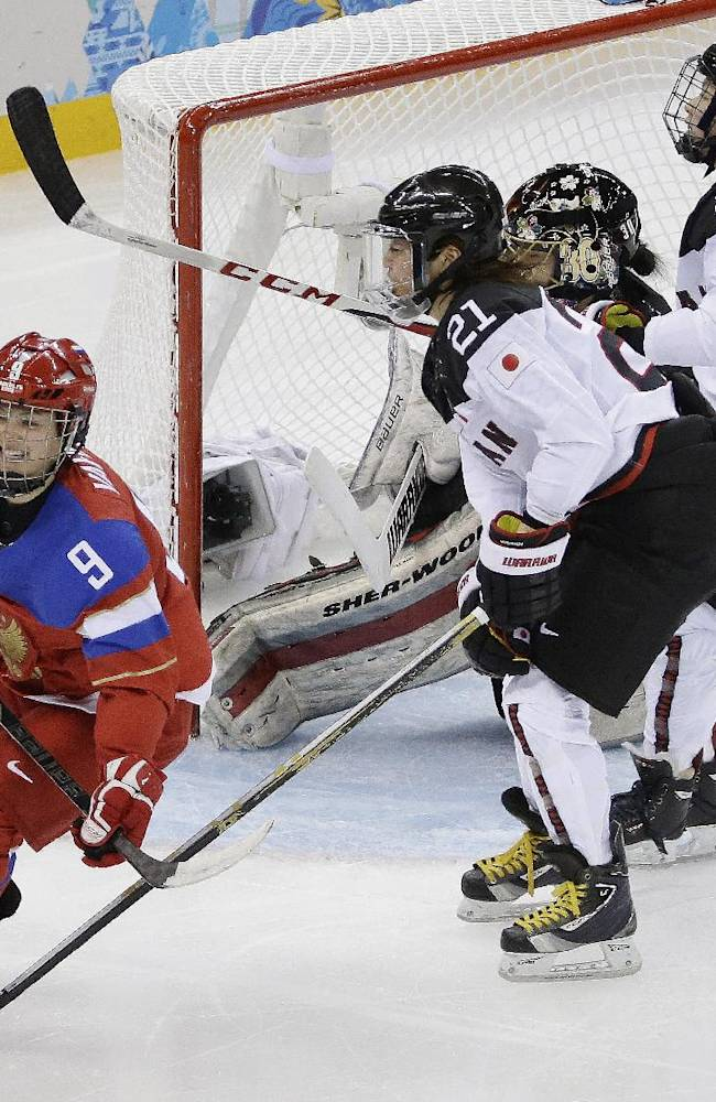 Alexandra Vafina of Russia smiles after scoring the game winning goal against Japan during the third period of the 2014 Winter Olympics women's ice hockey game at Shayba Arena, Tuesday, Feb. 11, 2014, in Sochi, Russia. Russia defeated Japan 2-1