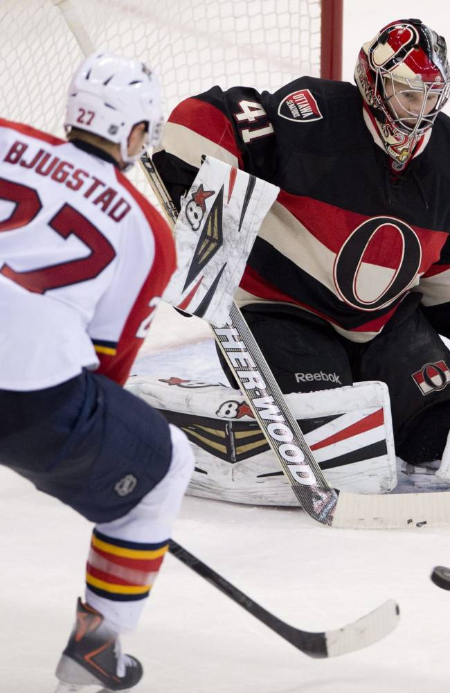 Florida Panthers center Nick Bjugstad, left, tries to put the puck past Ottawa Senators goalie Craig Anderson during second-period NHL hockey game action on Thursday, Dec. 19, 2013, in Ottawa, Ontario