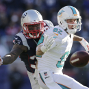 FILE - In this Dec. 14, 2014, file photo, Miami Dolphins wide receiver Brian Hartline (82) can't catch a pass in front of New England Patriots cornerback Brandon Browner, rear, in the first half of an NFL football game in Foxborough, Mass. Hartline was released Friday, Feb. 27, 2015, by the Miami Dolphins in the wake of a severe drop-off in productivity last season. (AP Photo/Charles Krupa, File)