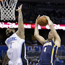 Indiana Pacers' Luis Scola (4), of Argentina, grabs a rebound away from Orlando Magic's Kyle O'Quinn (2) during the first half of an NBA basketball game in Orlando, Fla., Sunday, Feb. 9, 2014 The Associated Press