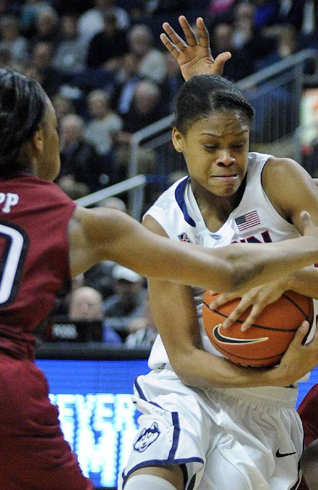Connecticut's Moriah Jefferson, center, drives past Temple's Shi-Heria Shipp, left, and Rateska Brown during the second half of Connecticut's 80-36 victory in an NCAA college basketball game in Bridgeport, Conn., Saturday, Jan. 11, 2014