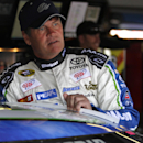 Michael Waltrip climbs into his car in the garage during practice for Sunday's Aaron's 499 NASCAR auto race at Talladega Superspeedway on Friday, May 2, 2014, in Talladega, Ala. (AP Images Photo/Butch Dill)